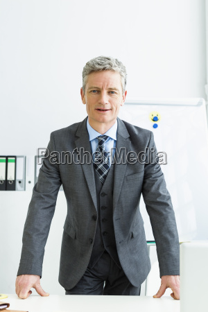 germany portrait of businessman standing in