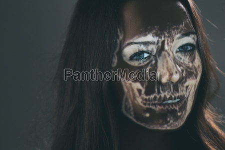 woman with projected skull on her