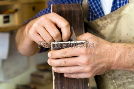 guitar maker in his workshop close