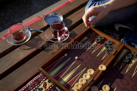 turkey istanbul woman playing tavla with