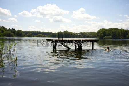 germany schleswig holstein woman swimming in