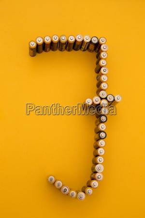 letter j formed of batteries at