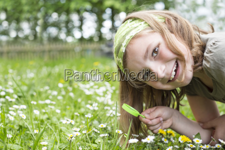 portrait of laughing girl crouching on
