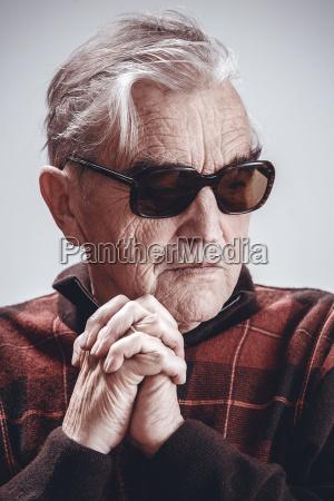 portrait of senior man wearing sunglasses