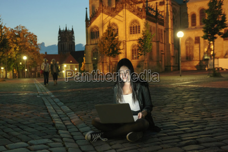 germany muenster young woman with laptop