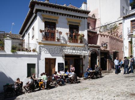 spain granada people sitting at restaurant