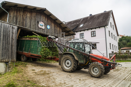 germany bavaria attenhofen travtor with hop