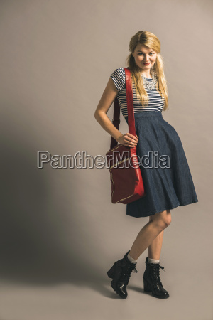 smiling blond young woman dressed like