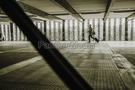 young businessman with baggage running in