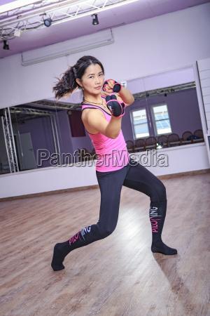 asian woman exercising piloxing
