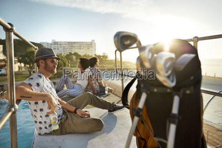 urban golfers sitting on highboard of
