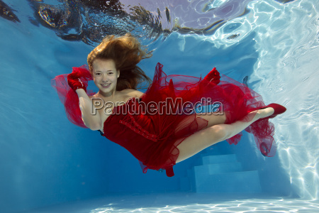 girl in red dress underwater