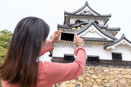 woman taking photo on hikone castle