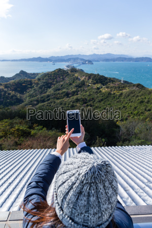 woman taking photo for the landscape