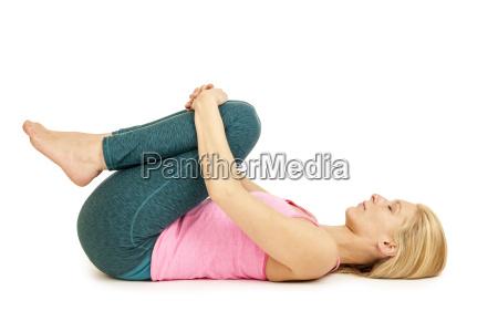 yoga woman pinkanada balasanafeets down