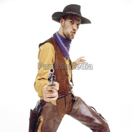 young man dressed as cowboy pointing