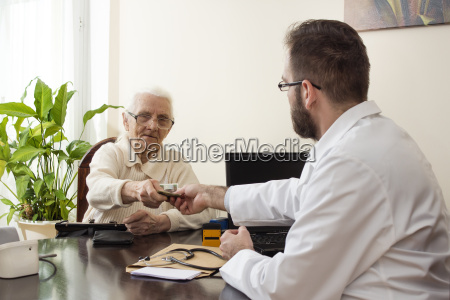 grandma pays the doctor for a