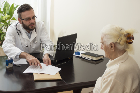 old woman at the doctor geriatrician