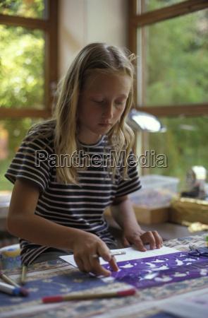girl drawing at table