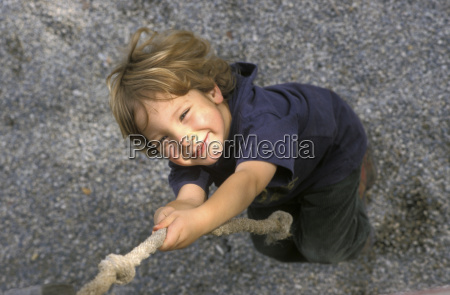 boy pulling rope elevated view