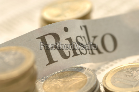 euro coins and risk note