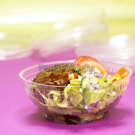 hamburger with mixed salad in plastic