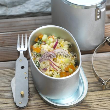 vegetable couscous in metal box close