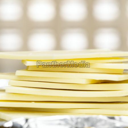 stacked white chocolate bars close up