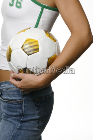 woman holding football under her arm