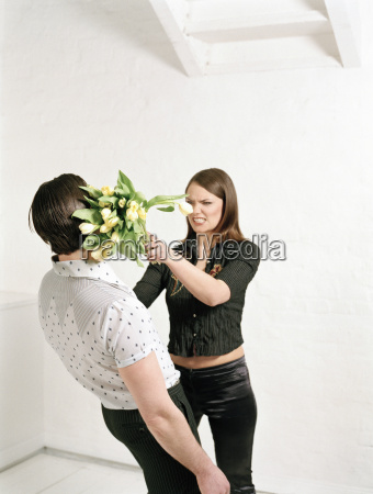 woman throwing bunch of flowers at