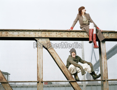 man and woman sitting on steel
