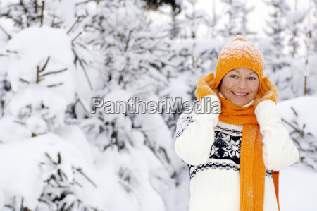 young woman with orange cap and