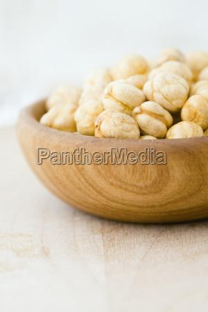 macadamia nuts in wooden bowl close