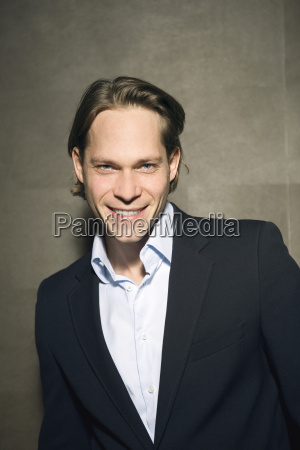 young businessman smiling portrait