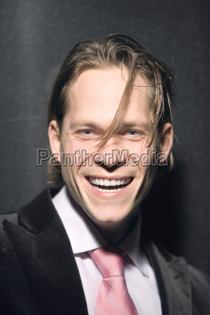 young businessman laughing portrait