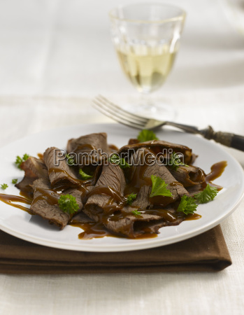 marinated beef carpaccio with sauce and