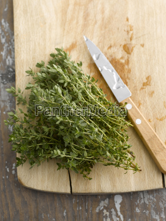 fresh thyme on chopping board elevated