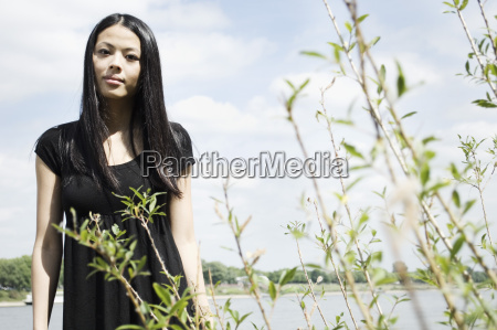 germany young woman standing near plants