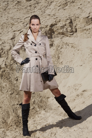 germany bavaria young woman in trench