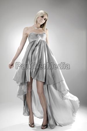 woman wearing grey halter top dress
