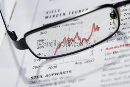 glasses on business journal close up