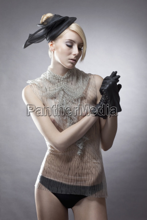 young woman with gloves looking down