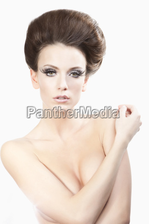naked woman against white background close