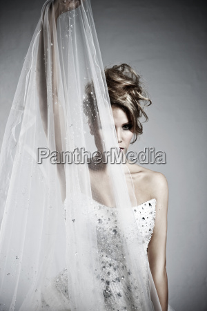 young bride in modern dress holding