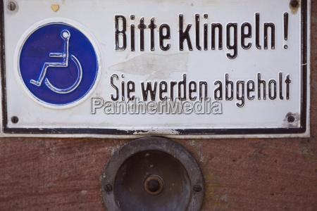 disabled sign on door with door