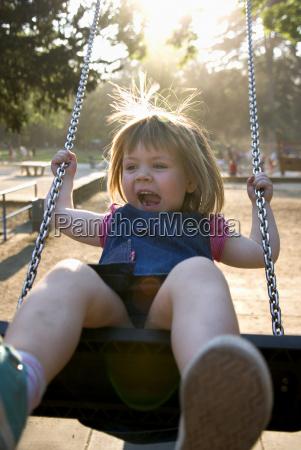 girl 3 4 on swing portrait