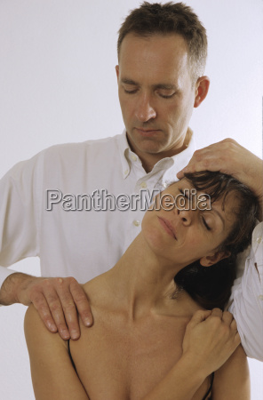 man massaging woman