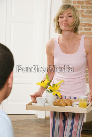 young woman serving breakfast close up