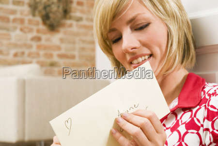 young woman holding mail portrait close