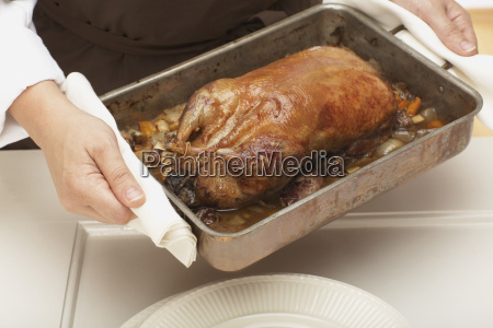 roast duck in roasting tray elevated